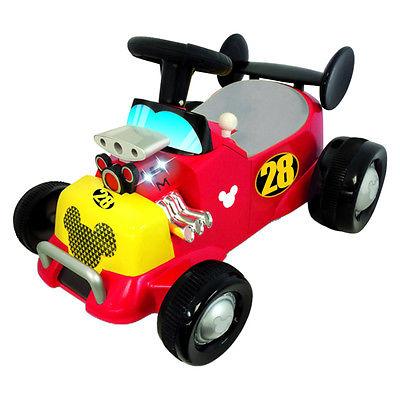 Каталка – пушкар, Спортивная машина Микки Мауса, свет, звукМашинки-каталки для детей<br>Каталка – пушкар, Спортивная машина Микки Мауса, свет, звук<br>