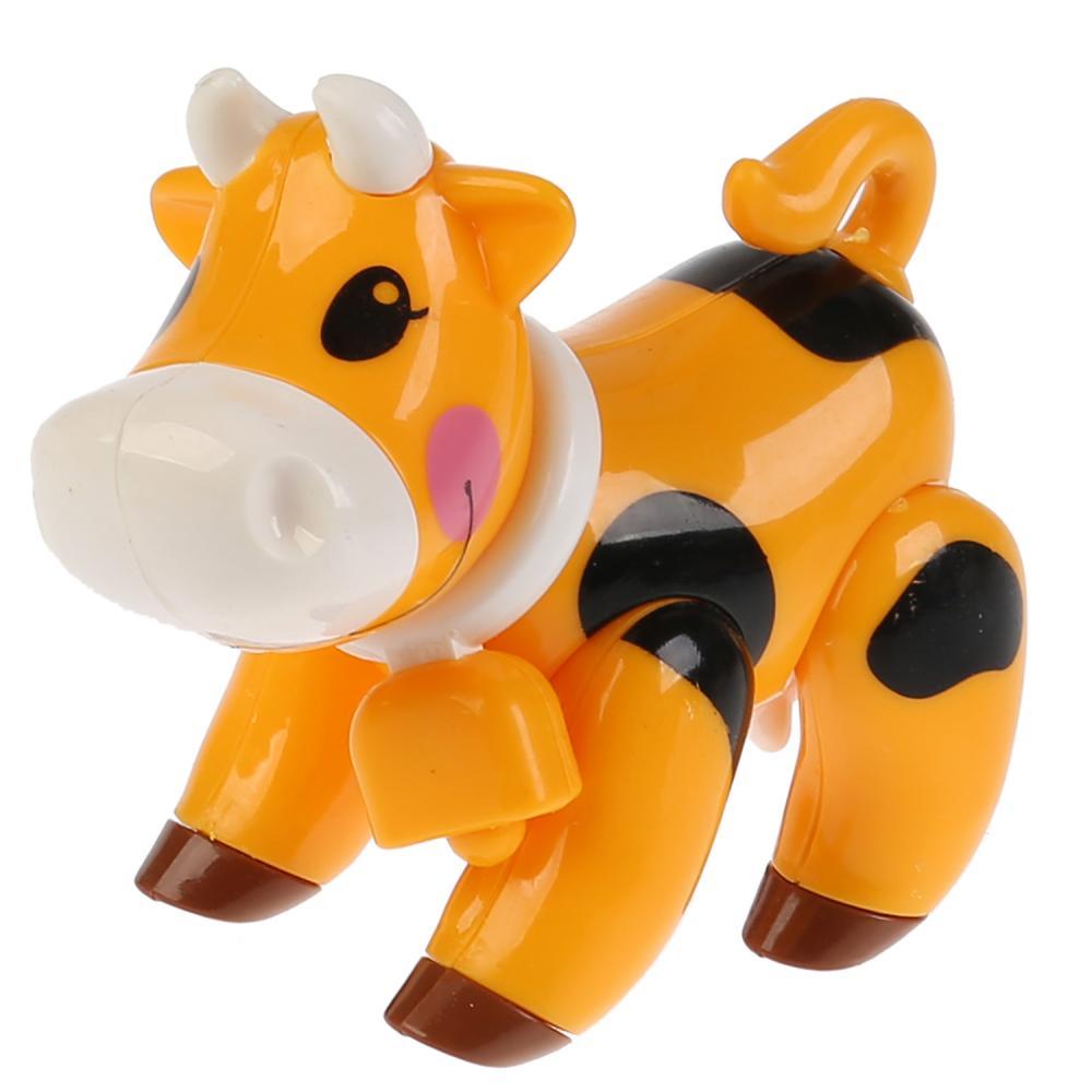 Развивающая крутилка Корова, оранжевый цвет фото