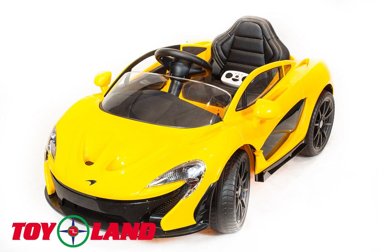 Электромобиль McLaren желтого цвета