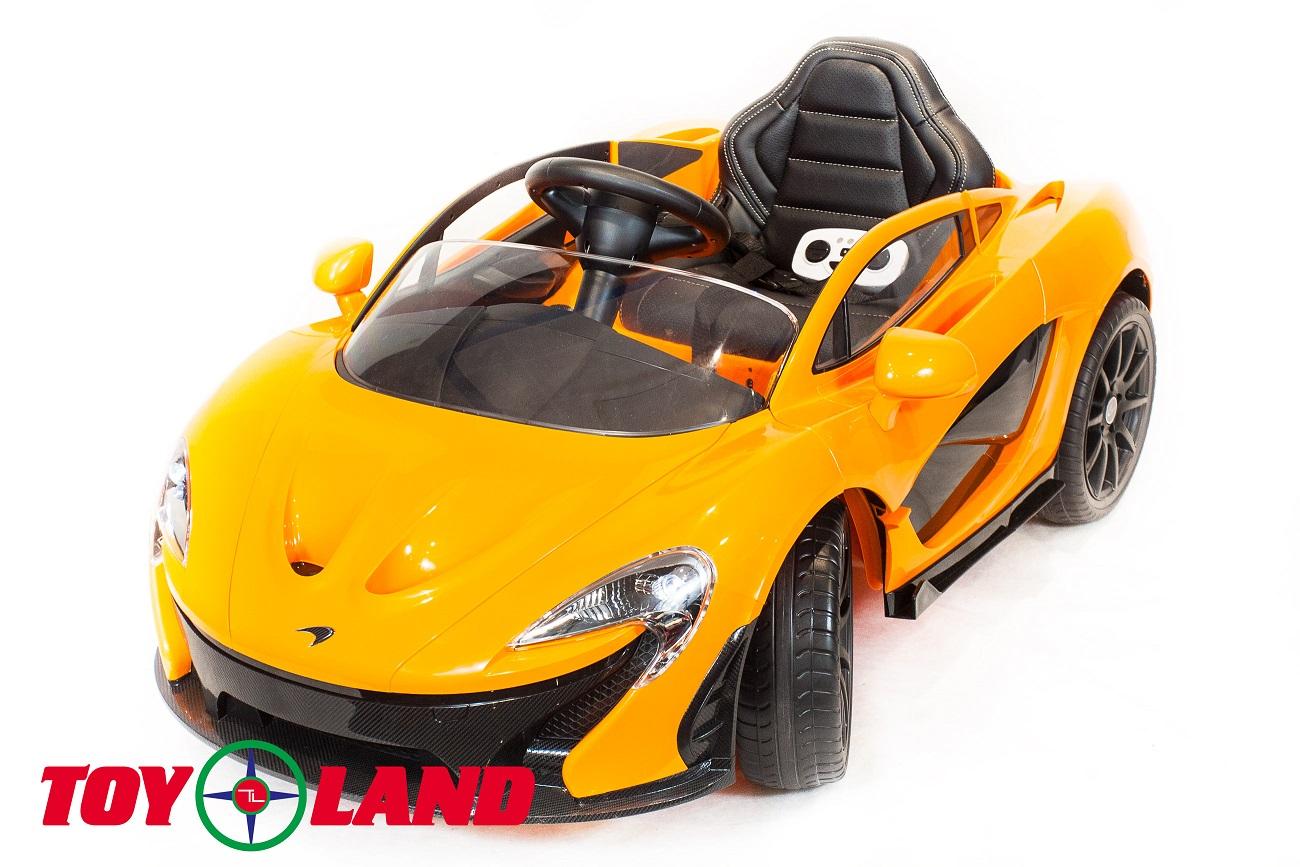 Электромобиль McLaren оранжевого цвета