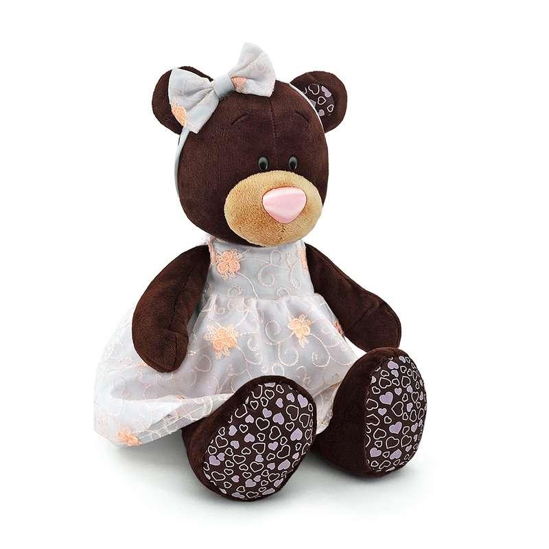 Мягкая игрушка - Медведь девочка Milk сидячая в платье с вышивкой, 25 смМедведи<br>Мягкая игрушка - Медведь девочка Milk сидячая в платье с вышивкой, 25 см<br>