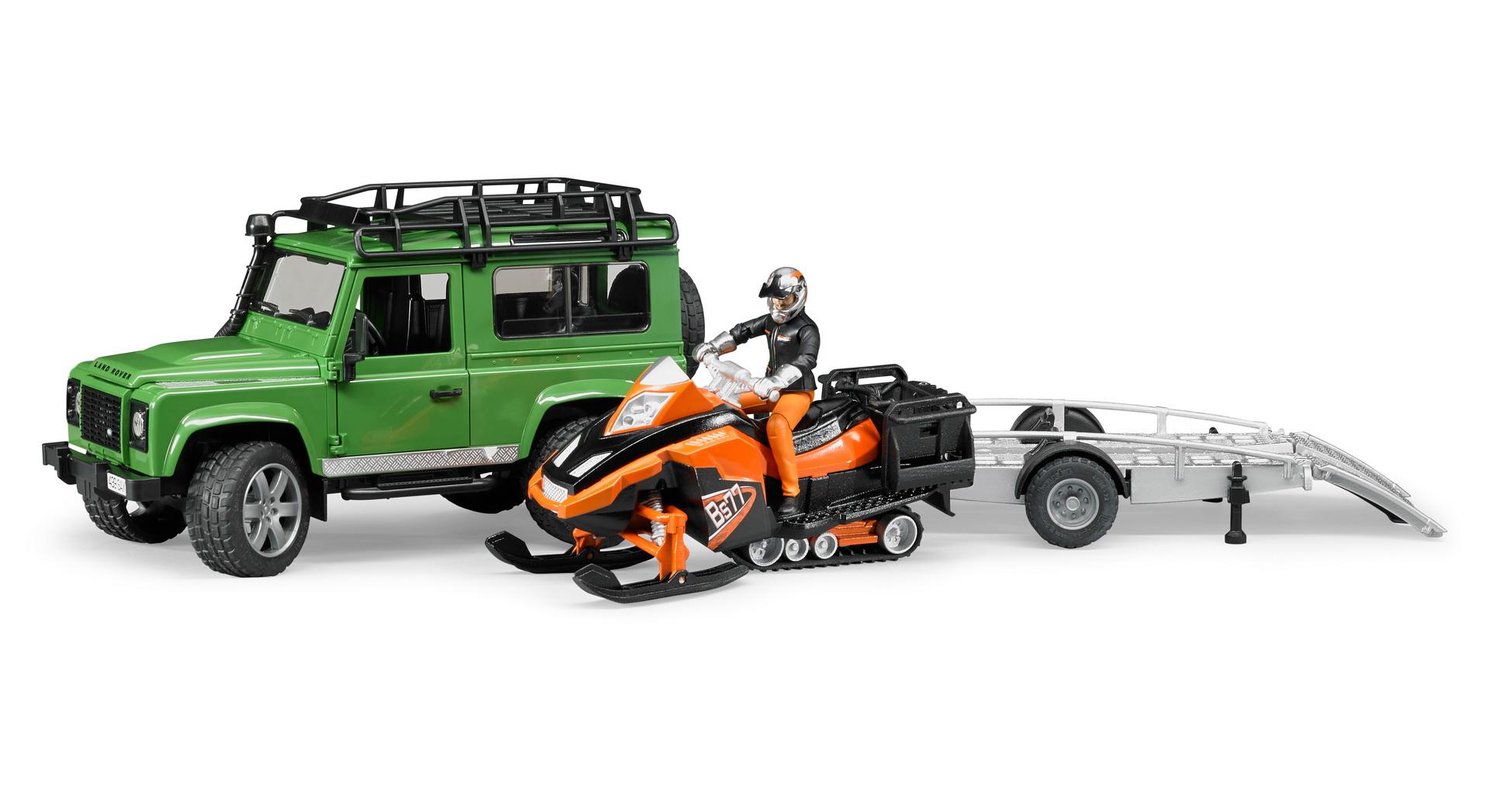 Внедорожник Land Rover Defender с прицепом, снегоходом и водителемLand Rover<br>Внедорожник Land Rover Defender с прицепом, снегоходом и водителем<br>
