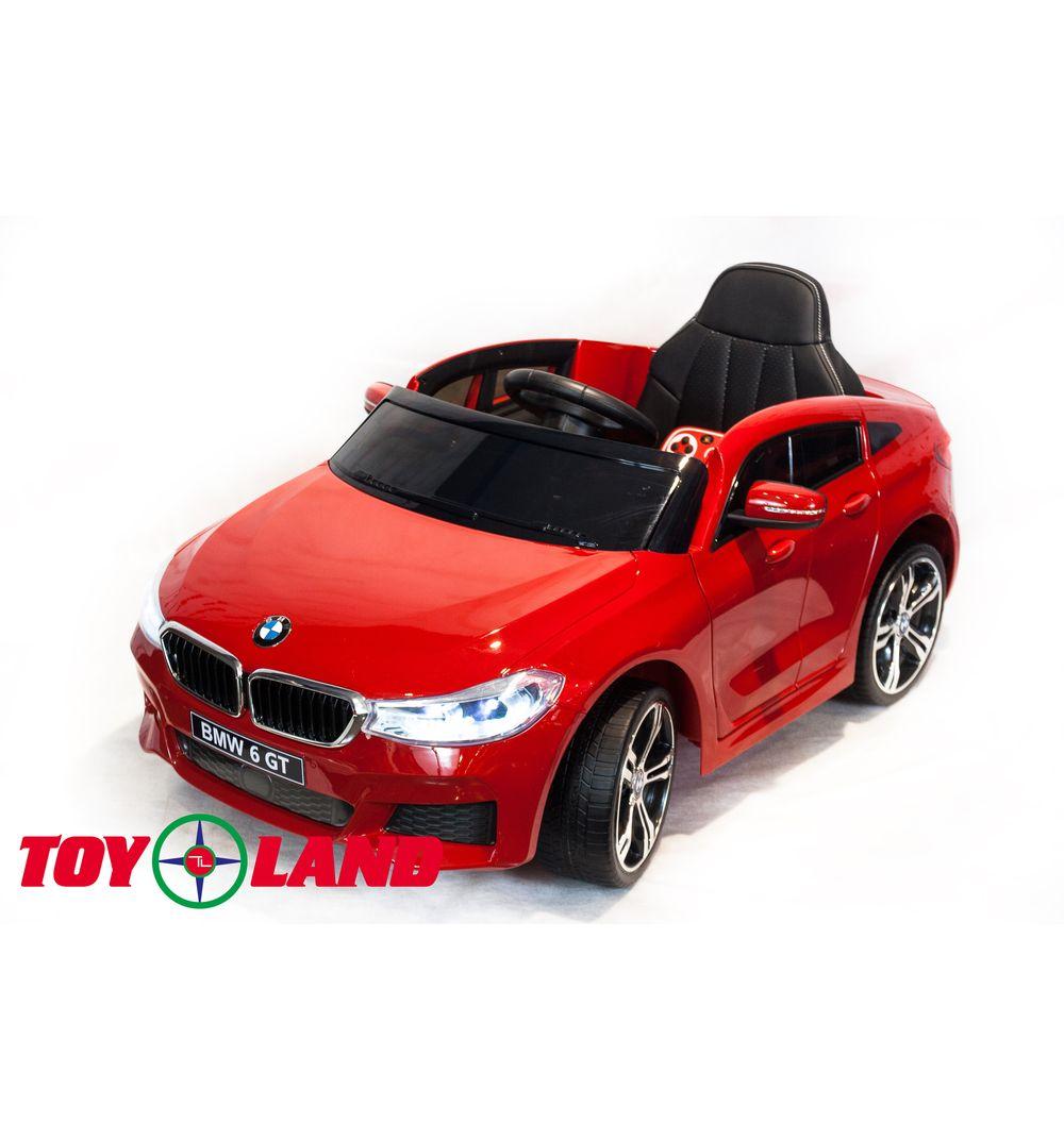Электромобиль BMW 6 GT, цвет - красный глянец фото